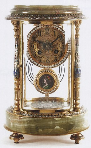 Onyx and Champleve Enamel decorated circular case Crystal Regulator mantel clock. -SOLD-