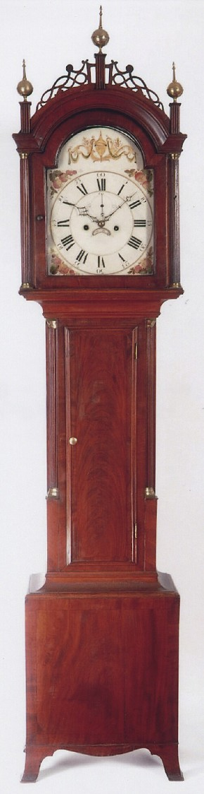 South Eastern Massachusetts tall case clock featuring a cross-banded mahogany case. NN71.