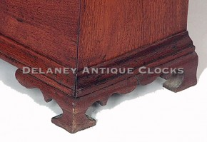 Ogee bracket feet on a tall case case clock.