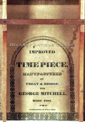 Miniature stencil columns and splat shelf clock label. Made by Treat & Bishop for George Mitchell.